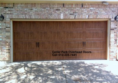Clopay Carriage House Door. Long Panel Light Oak Fuax wood colors